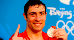 Ken Egan with his Olympic silver medal in Beijing. Photo: Sportsfile