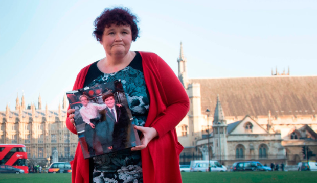 Claire Throssell holds a photograph of her two boys Paul and Jack. Photo: Stefan Rousseau/PA Wire