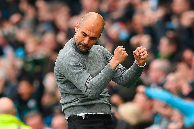 In this file photo taken on April 07, 2018 Manchester City's Spanish manager Pep Guardiola celebrates. AFP PHOTO / Paul ELLIS