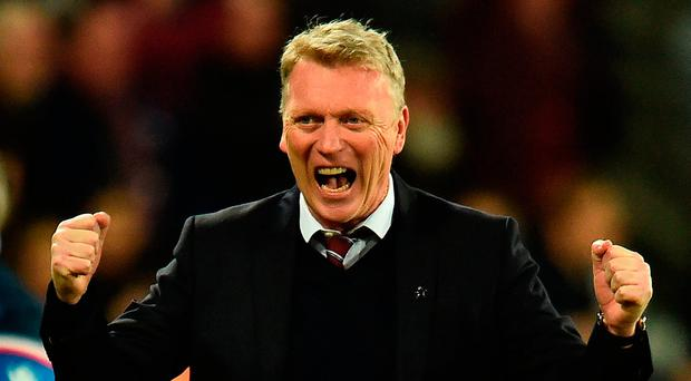 West Ham United's Scottish manager David Moyes celebrates after West Ham United's English striker Andy Carroll scored his teams first goal during the English Premier League football match between West Ham United and Stoke City at The London Stadium, in east London on April 16, 2018. / AFP PHOTO / Glyn KIRK