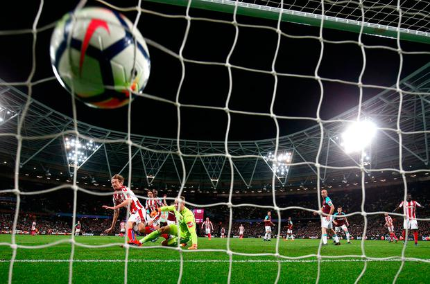 Peter Crouch reacts quicker than West Ham goalkeeper Joe Hart to give Stoke the lead. Photo: PA