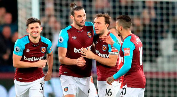 Andy Carroll (second left) celebrates scoring West Ham's late equaliser against Stoke at the London Stadium. Photo: PA