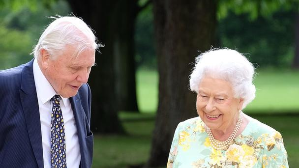 The Queen and Sir David Attenborough in the gardens of Buckingham Palac