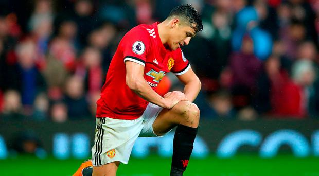 Manchester United's Alexis Sanchez picks himself up after a challenge at the weekend. Photo: PA