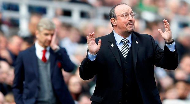 Rafael Benitez issues instructions to his Newcastle players in front of Arsenal boss Arsene Wenger. Photo: REUTERS