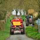 Total gridlock: Farmer Paddy Cummins is pictured (left) transporting a bale and pulling in for the oncoming sprayer on a narrow country lane near his farm in Borris, Co Carlow. Photo: Roger Jones.