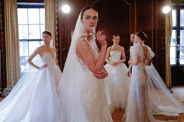 6334f234f2c2 Backstage at Monique Lhuillier Spring 2019 Bridal show at New York Bridal  Fashion Week 2018