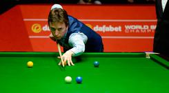 SHEFFIELD, ENGLAND - APRIL 26: Ken Doherty plays a shot against Alan McManus during their second round match in The Dafabet World Snooker Championship at Crucible Theatre on April 26, 2014 in Sheffield, England. (Photo by Gareth Copley/Getty Images)