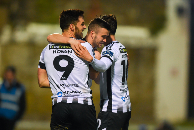 17 April 2018; Michael Duffy of Dundalk, centre, celebrates with team-mates Patrick Hoban and Jamie McGrath after scoring his side's third goal during the SSE Airtricity League Premier Division match between Limerick FC and Dundalk at the Markets Field in Limerick. Photo by Diarmuid Greene/Sportsfile