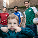 Andy Moran, Seán Óg Ó hAilpín, Cian O'Sullivan and Paul Geaney with eight-year-old Adam Goldrick McCann at the launch of the #AllIrelandSmiles campaign for 2018, which aims to educate Ireland's primary school students on the importance of good oral hygiene. For more information, visit www.corsodyl.ie