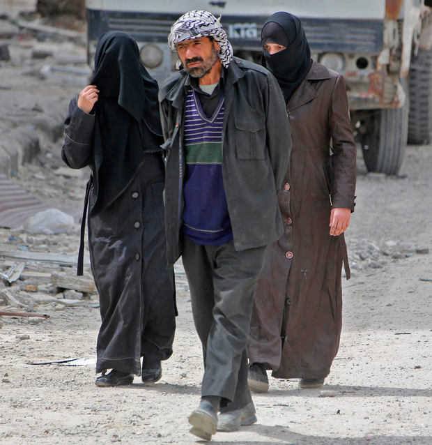 Civilians walk in Douma yesterday. Photo: Getty