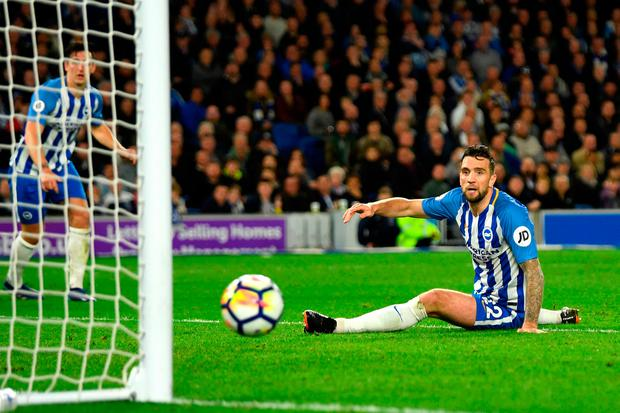 Shane Duffy of Brighton and Hove Albion looks on as he almost scores an own goal Photo: Getty