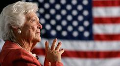 Former US first lady Barbara Bush listens to her son, President George W. Bush, as he speaks at an event on social security reform in Orlando, Florida March 18, 2005. Photo: Reuters