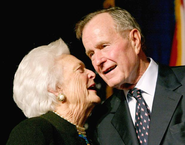 Former US President George Bush speaks with his wife Barbara as their son, Florida Republican gubernatorial candidate, incumbent Gov. Jeb Bush, celebrates victory at his election night party in Miami November 5, 2002. Photo: Reuters