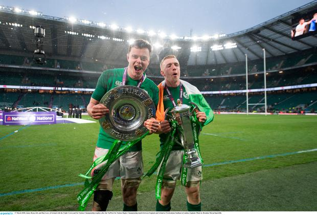 James Ryan, left, and Dan Leavy of Ireland with the Triple Crown and Six Nations Championship trophies