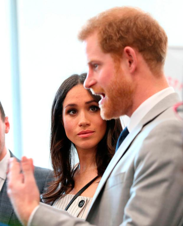 Meghan Markle looks at Prince Harry during a reception for delegates from the Commonwealth Youth Forum at the Queen Elizabeth II Conference Centre, London, during the Commonwealth Heads of Government Meeting