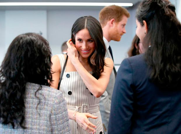 Prince Harry and Meghan Markle (both centre)during a reception with delegates from the Commonwealth Youth Forum at the Queen Elizabeth II Conference Centre, London, during the Commonwealth Heads of Government Meeting. Yui Mok/PA Wire