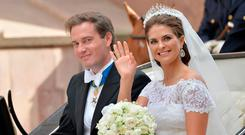Christopher O'Neill and Princess Madeleine of Sweden are taken by horse and carriage from the Royal Palace of Stockholm to Riddarholmen after the wedding of Princess Madeleine of Sweden and Christopher O'Neill hosted by King Carl Gustaf XIV and Queen Silvia at The Royal Palace on June 8, 2013 in Stockholm, Sweden. (Photo by Torsten Laursen/Getty Images)