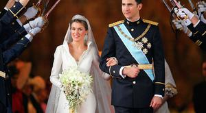 Princess of Asturias Letizia Ortiz and Spanish Crown Felipe of Bourbon leave Madrid's Almudena Cathedral at the end of their wedding ceremony 22 May 2004.