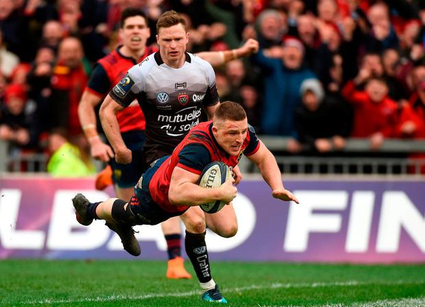 Andrew Conway leaves Chris Ashton in his wake before diving over for Munster's dramatic, late try against Toulon last month. Photo by Diarmuid Greene/Sportsfile