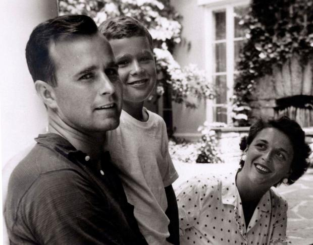 George W Bush is shown with his father, fellow future US President George HW Bush, and mother, future first lady Barbara Bush in 1955. Photo: Reuters