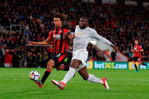 Romelu Lukaku of Manchester United scores his sides second goal past Nathan Ake of AFC Bournemouth Photo: Getty