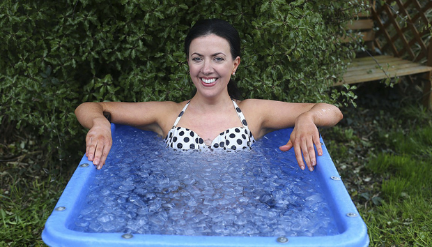 Deirdre Reynolds practicing the Wim Hof method of bathing in ice. Photo: Damien Eagers