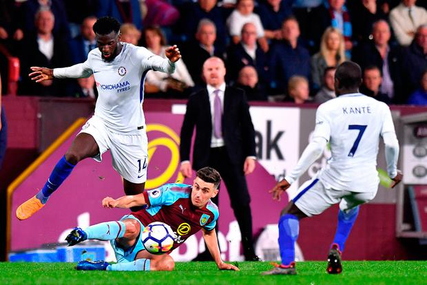 Chelsea's Tiemoue Bakayoko (left) and Burnley's Matthew Lowton (centre) battle for the ball. Photo: Anthony Devlin/PA Wire