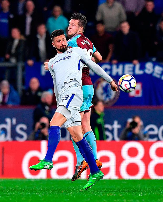 Chelsea's Olivier Giroud (left) and Burnley's Kevin Long (right) battle for the ball. Photo: Anthony Devlin/PA Wire