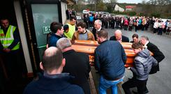Big Tom's remains arrive for public reposal at Oram Community Centre. Photo: Steve Humphreys