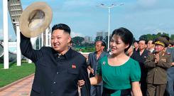 North Korean leader Kim Jong-un with his wife Ri Sol-Ju at the Rungna People's Pleasure Ground. Photo: Getty Images