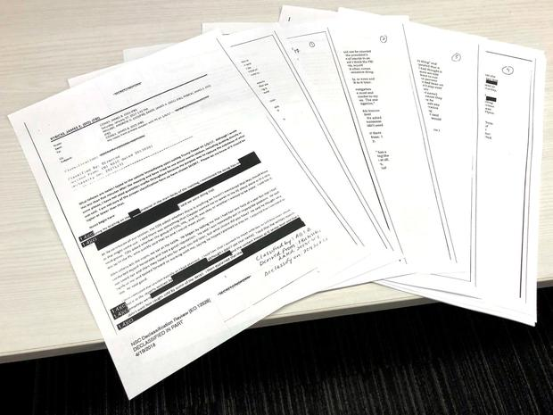The partially redacted memos of former FBI Director James Comey, recounting conversations with President Donald Trump last year, are pictured after U.S. Justice Department released them to three House of Representatives committees in Washington, DC, U.S., April 19, 2018. REUTERS/Gavino Garay