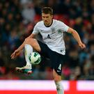 Michael Carrick in action with England