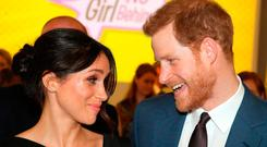 Britain's Prince Harry (R) and his fiancee, US actress Meghan Markle, attend a reception for Women's Empowerment at the Royal Aeronautical Society in central London, on the fourth day of the Commonwealth Heads of Government Meeting (CHOGM) on April 19, 2018. / Getty Images / POOL / CHRIS JACKSONCHRIS JACKSON/AFP/Getty Images