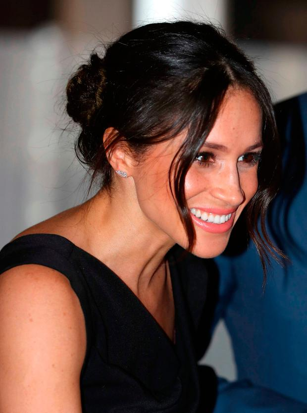 Britain's Prince Harry's fiancee, US actress Meghan Markle, attends a reception for Women's Empowerment at the Royal Aeronautical Society in central London, on the fourth day of the Commonwealth Heads of Government Meeting (CHOGM) on April 19, 2018. / Getty Images / POOL / CHRIS JACKSONCHRIS JACKSON/AFP/Getty Images