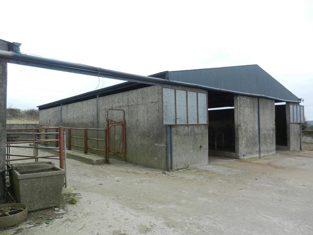 The yard, separate from the house has a range of farm buildings
