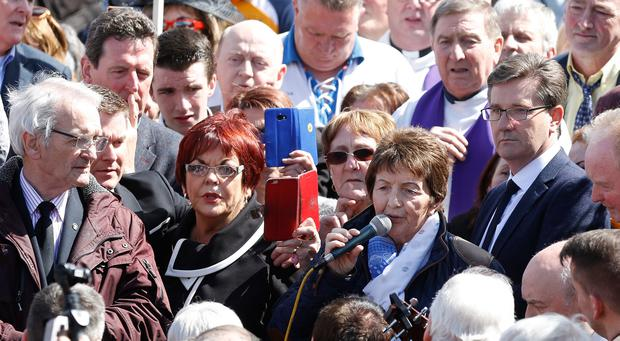 Margo O'Donnell, with her brother Daniel, left, Susan McCann and Michael English singing at the graveside of Big Tom after his funeral at St Patricks church in Oram, Co. Monaghan. Picture credit; Damien Eagers
