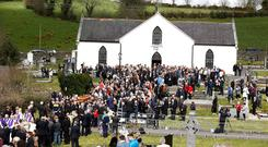 The coffin is carried from St Patricks Church after the funeral of Big Tom in Oram, Co. Monaghan. Picture credit; Damien Eagers