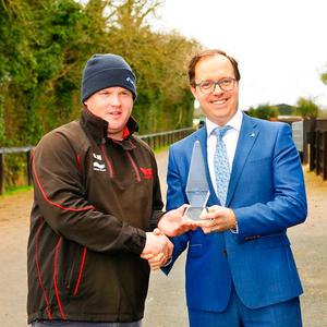 Trainer Gordon Elliott receiving the Philips Lighting Manager of the Month award for March from Dermot Deeley