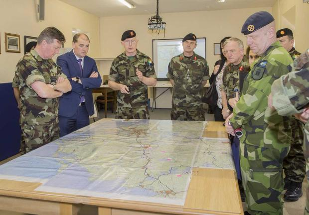 Minister Kehoe and Vice Admiral Mellet being briefed as part of the multinational Exercise Viking in Custume Barracks