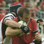 Rob Henderson, is tackled by Trevor Brennan (left) and Yannick Bru during Munster's European cup semi-final against Toulouse in 2003. Photo: Sportsfile