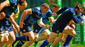 Tadhg Furlong (centre) and Cian Healy (right) lead the Leinster players through their paces during the Captain's Run at the Aviva Stadium yesterday. Photo: Sportsfile