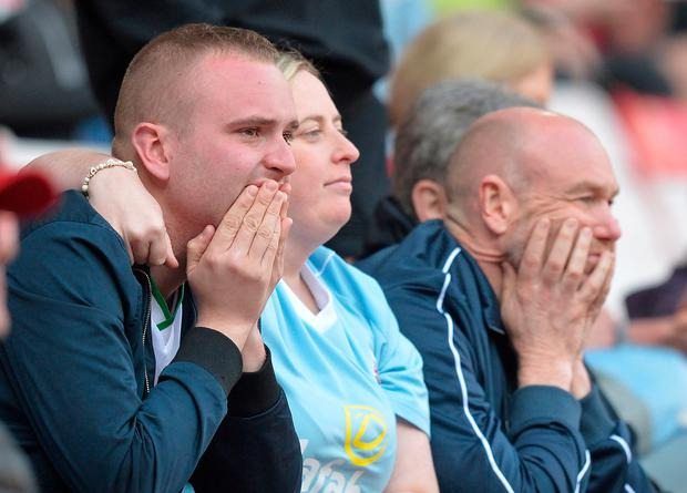 Dejected Sunderland fans watch as their team are relegated during the Sky Bet Championship match at the Stadium of Light