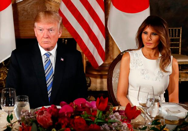 Donald Trump, with his wife Melania, reportedly said the 'hookers thing' is nonsense. Photo: AP