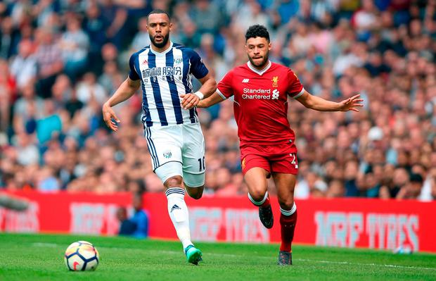 West Bromwich Albion's Matt Phillips and Liverpool's Alex Oxlade-Chamberlain. Photo: Nigel French/PA Wire