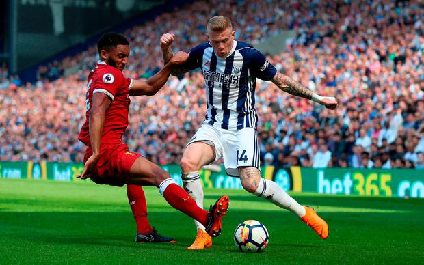Liverpool's Joe Gomez and West Bromwich Albion's James McClean. Photo: Nigel French/PA Wire