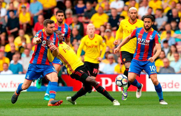 Crystal Palace's James McArthur (left) and Watford's Abdoulaye Doucoure (centre) battle for the ball. Photo: Jonathan Brady/PA Wire