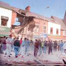 The devastation outside Frizzell's fish shop on the Shankill Road in 1993, after an IRA bomb killed nine people out shopping
