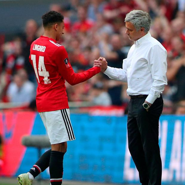 Manchester United's Jesse Lingard shakes hands with manager Jose Mourinho. Photo: Hannah McKay/Reuters