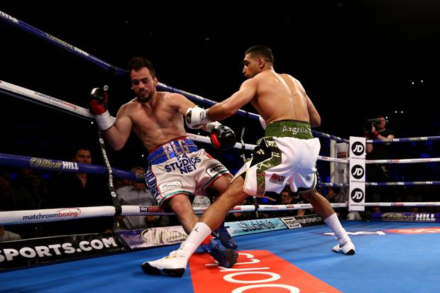 LIVERPOOL, ENGLAND - APRIL 21: Amir Khan of England knocks out Phil Lo Greco of Italy during their Super Welterweight bout at Echo Arena on April 21, 2018 in Liverpool, England. (Photo by Jan Kruger/Getty Images)